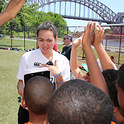 Losi Sa'u Lilo talks with young rugby players to understand nutrition through a quiz and questionnaire during the 7th Annual AIG NYC Rugby Cup at Randall's Island, Manhattan, New York. Losi Sa'u Lilo, is an intern at Play Rugby USA through the AUT inter NZ scholarship program. Randall's Island, Manhattan,  New York.  USA. 7th June 2014. Photo Tim Clayton