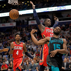 Apr 3, 2019; New Orleans, LA, USA;  Charlotte Hornets guard Kemba Walker (15) passes as New Orleans Pelicans forward Cheick Diallo (13) defends during the second quarter at the Smoothie King Center. Mandatory Credit: Derick E. Hingle-USA TODAY Sports