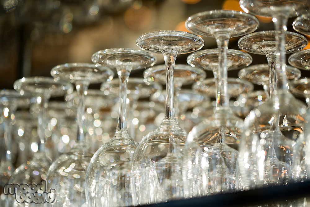 Wine glasses in row on bar counter close-up