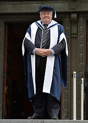 Holywood blockbuster director Iain Smith celebrates after being awarded an honorary degree by Queen Margaret University in Edinburgh's new chancellor, Great British Bake Off judge Prue Leith.<br /> <br /> © Dave Johnston/ EEm