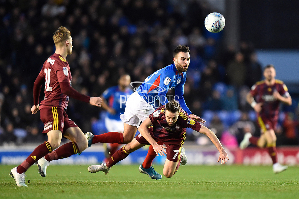 Ben Close (33) of Portsmouth battles for possession with Gwion Edwards (7) of Ipswich Town during the EFL Sky Bet League 1 match between Portsmouth and Ipswich Town at Fratton Park, Portsmouth, England on 21 December 2019.