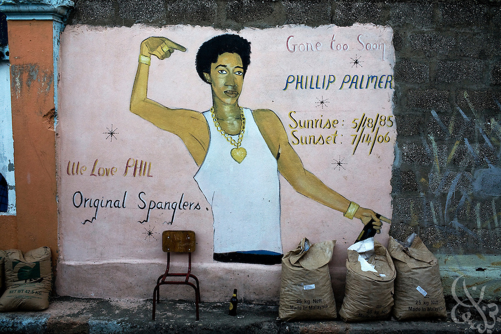 A graffiti mural paying homage to a fallen gang member belonging to the Spangler gang decorates a ghetto wall June 17, 2008 in the Southside inner-city community of Kingston, Jamaica. The Spanglers are a traditionally People's National Party (PNP) linked gang that controls the area of Southside.
