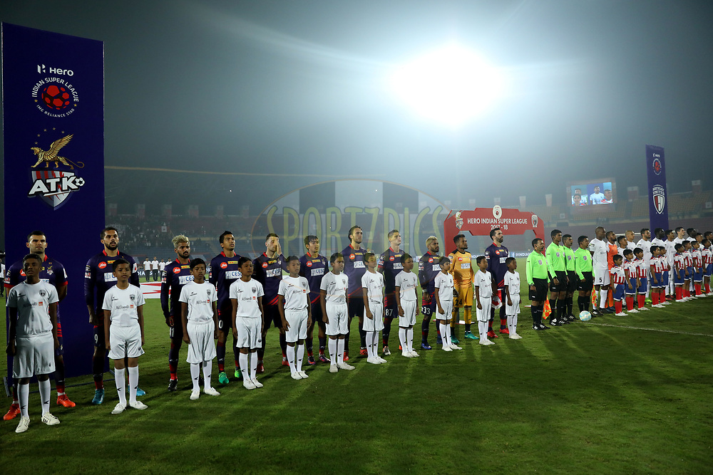 Players lineup for national anthem during match 45 of the Hero Indian Super League between NorthEast United FC and ATK  held at the Indira Gandhi Athletic Stadium, Guwahati India on the 12th January 2018<br /> <br /> Photo by: Arjun Singh  / ISL / SPORTZPICS