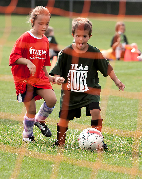 Carson Tucker looks to make a shot at the goal during the Laconia Youth Soccer programs opening day on Saturday morning.  (Karen Bobotas/for the Laconia Daily Sun)