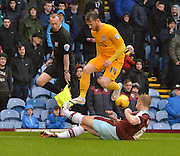 Preston North End Forward, Joe Garner has to jump out of the way of a challenge from Burnley Defender, Ben Mee  during the Sky Bet Championship match between Burnley and Preston North End at Turf Moor, Burnley, England on 5 December 2015. Photo by Mark Pollitt.