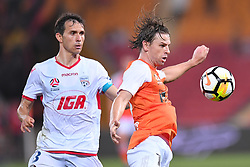 October 13, 2017 - Brisbane, QUEENSLAND, AUSTRALIA - Brett Holman of the Roar (#10, right) controls the ball in front of Isaias of Adelaide (#8) during the round two A-League match between the Brisbane Roar and Adelaide United at Suncorp Stadium on October 13, 2017 in Brisbane, Australia. (Credit Image: © Albert Perez via ZUMA Wire)