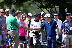September 24, 2017 - Atlanta, Georgia, United States - Justin Rose (R) shakes hands with a fan on the first green during the final round of the TOUR Championship at the East Lake Club. (Credit Image: © Debby Wong via ZUMA Wire)