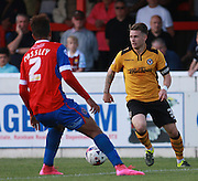 Newport County player Mark Byrne looks for an opening during the Sky Bet League 2 match between Dagenham and Redbridge and Newport County at the London Borough of Barking and Dagenham Stadium, London, England on 19 September 2015. Photo by Bennett Dean.