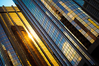 Reflections of the golden sunrise off a highrise building in downtown Calgary at Sunrise. The skyline is beautiful in the morning and I love this intimate partial view of it.<br /> <br /> ©2010, Sean Phillips<br /> http://www.Sean-Phillips.com