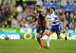 Bournemouth's Andrew Surman chases down the ball under pressure from Reading's Jem Karacan- Photo mandatory by-line: Alex James/JMP - Mobile: 07966 386802 - 14/04/2015 - SPORT - Football - Reading - Madejski Stadium - Reading v AFC Bournemouth - Sky Bet Championship