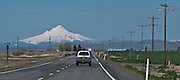 scene along a cross country trip with in a classic Mini Cooper auto - Mt Hood is viewed from US 26 with a powerline paralleling the highway