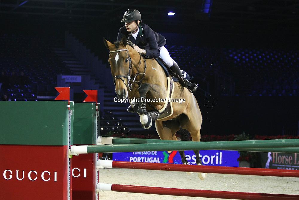 Equitation : Gucci Masters - 03.12.2010 - Rolex Speed Challenge CSI5 - Denis Lynch (IRL/ Upsilon D Ocquier) *** Local Caption *** 00042820