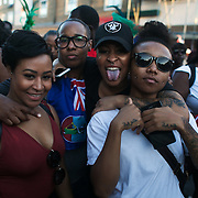 Ridley Road, girls out to party. Hackney carnival 2016 took place on a hot Indian summer's day, September 2016 with the streets full of partying people.