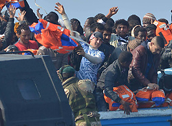 Migrants who were stranded on a boat, thirty miles off the Libyan coast arrive in Sicily after they were rescued by Royal Marines from HMS Bulwark.