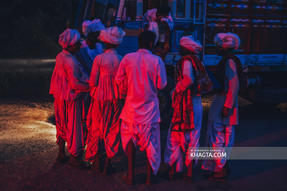 People of Maldhari tribe in Gujarat standing in front of a truck.