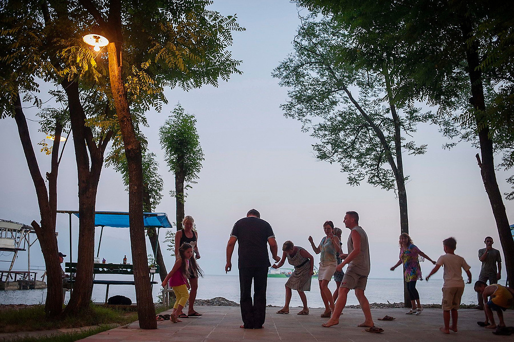 Russian tourists dance near the shore at the Sukhumi Red Army Sanatorium, a holiday complex owned by a Moscow army regiment. Abkhazia
