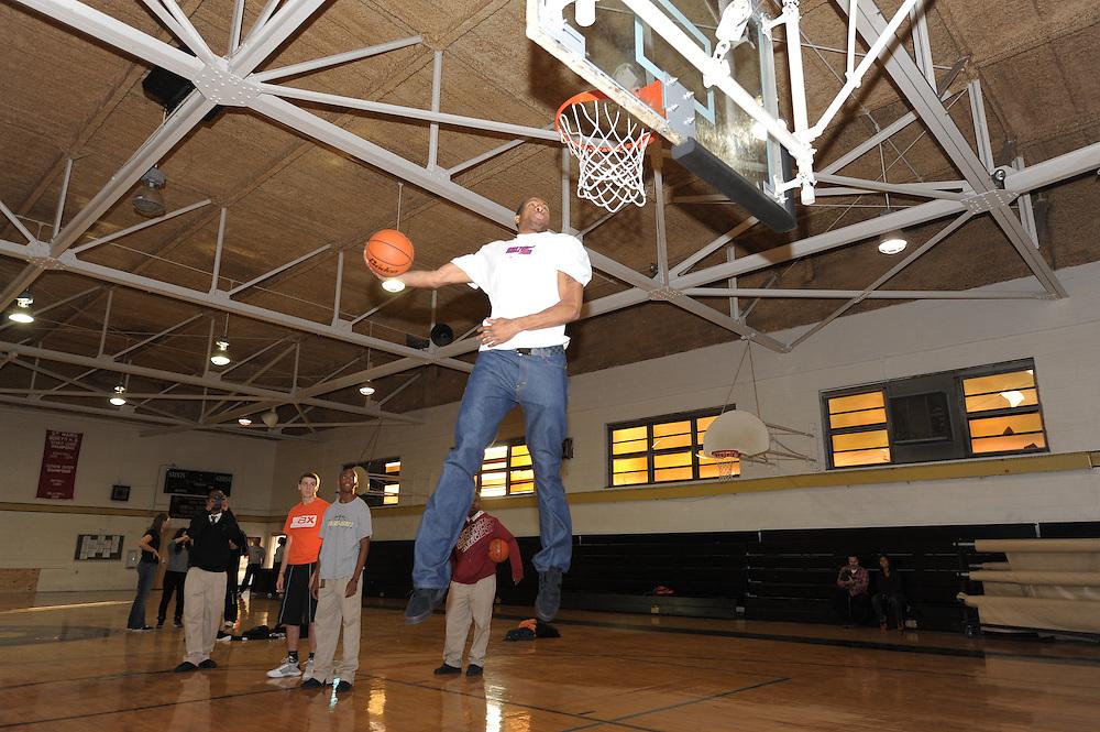 PHILADELPHIA - NOVEMBER 17:  Andre Iguodala of the Philadelphia 76ers helps high school students design their new Nike basketball sneakers on November 17, 2009 at Neumann Goretti High School in Philadelphia, Pennsylvania. (Photo by Drew Hallowell)