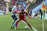 Swindon Town defender,on loan from Southampton, Jordan Turnbull (6)  shields the ball from Coventry City midfielder Andy Rose (16)  during the Sky Bet League 1 match between Coventry City and Swindon Town at the Ricoh Arena, Coventry, England on 19 March 2016. Photo by Simon Davies.