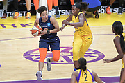 Connecticut Sun guard Layshia Clarendon (23) runs across the court while Los Angeles Sparks guard Chelsea Gray (12) pursues to defend during a WNBA basketball game, Friday, May 31, 2019, in Los Angeles.The Sparks defeated the Sun 77-70.  (Dylan Stewart/Image of Sport)