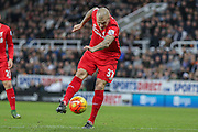 Liverpool defender Martin Skrtel  with a shot on goal during the Barclays Premier League match between Newcastle United and Liverpool at St. James's Park, Newcastle, England on 6 December 2015. Photo by Simon Davies.