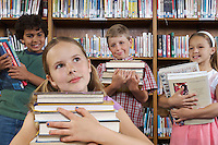 School children holding books in library