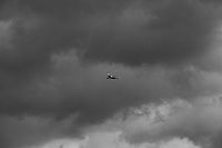An airplane flies through a storm over Indianapolis