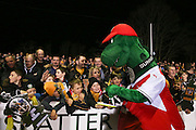 Gunnersaurus, the Arsenal mascot signs autographs for fans during the The FA Cup match between Sutton United and Arsenal at Gander Green Lane, Sutton, United Kingdom on 20 February 2017. Photo by Phil Duncan.