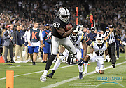 Sep 10, 2018; Oakland, CA, USA; Oakland Raiders tight end Jared Cook (87) is pursued by Los Angeles Rams defensive back Aqib Talib (21) and defensive back John Johnson (43) at the Oakland-Alameda County Coliseum. The Rams defeated the Raiders 33-13.