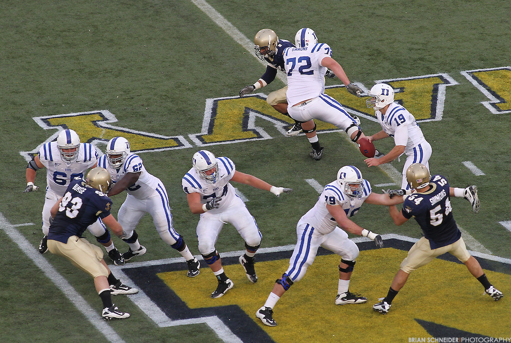 Oct 30, 2010; Annapolis, MD, USA; Duke Blue Devils quarterback Sean Renfree (19) scrambles against the Navy Midshipmen during the second half at Navy-Marine Corp Memorial Stadium. Mandatory Credit: Brian Schneider-www.ebrianschneider.com