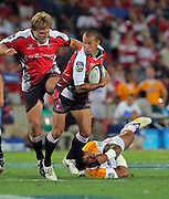 JOHANNESBURG, South Africa, 19 February 2010. Carlos Spencer of the Lions is tackled by Sione Lauaki of the Chiefs during the Super 14 match between the Lions and the Chiefs at Coca-Cola Park in Johannesburg, South Africa on 19 February 2010.<br /> Photographer : Anton de Villiers / SPORTZPICS