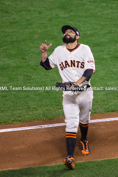 October 24, 2014: San Francisco Giants relief pitcher Sergio Romo (54) points skyward at the end of the inning, during game three of the World Series between the San Francisco Giants and the Kansas City Royals at AT&T Park in San Francisco, California, USA.