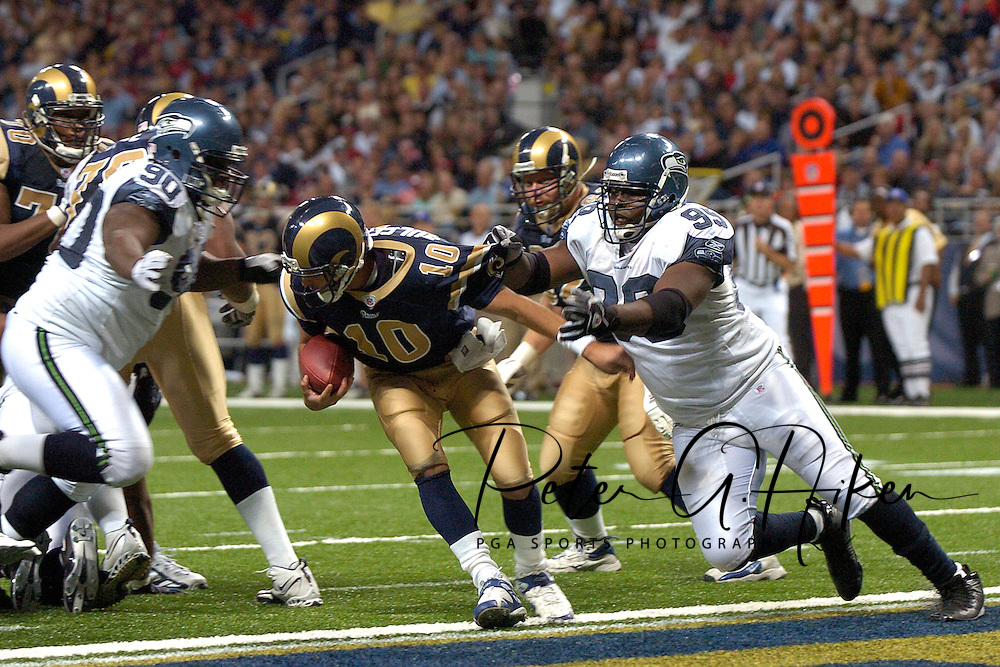 Seattle defenders Rocky Bernard (99) and Marcus Tubbs (90) pressure St. Louis quarterback Mark Bulger (10) in the second half at the Edward Jones Dome in St. Louis, Missouri, October 15, 2006.  The Seahawks beat the Rams 30-27.<br />