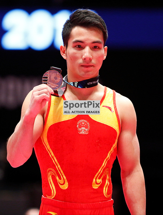 2015 Artistic Gymnastics World Championships being held in Glasgow from 23rd October to 1st November 2015.....Shudi Deng (Peoples Republic of China) Bronze medal winner in the Men's All-Round Final...(c) STEPHEN LAWSON | SportPix.org.uk