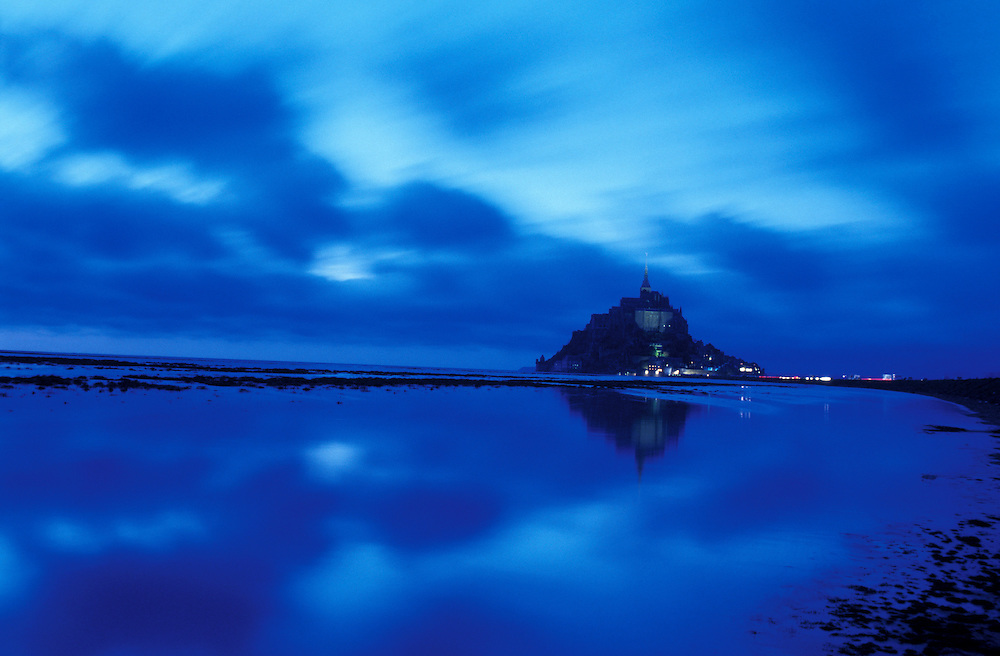 Le Mont St.Michel at dusk with tidal marsch, Normandie, Normany, France