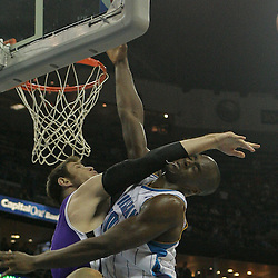 Dec 08, 2009; New Orleans, LA, USA; Sacramento Kings forward Andres Nocioni (5) hits New Orleans Hornets center Emeka Okafor (50) in the face following a blocked shot during the second half at the New Orleans Arena. The Hornets defeated the Kings 96-94. Mandatory Credit: Derick E. Hingle-US PRESSWIRE