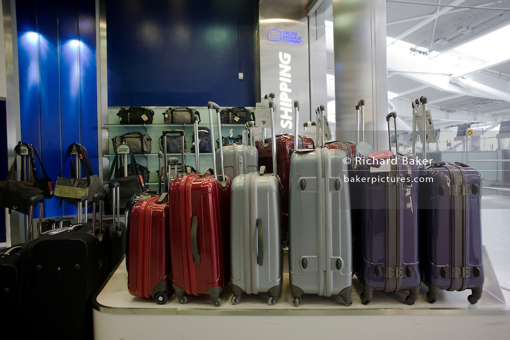 Suitcases on sale at the Excess Baggage' shop in departures at Heathrow airport's terminal 5. .