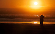 Ocean Shores, WA is for lovers as this couple proves in a sunset embrace.
