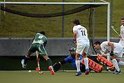 Black Sticks goalkeeper Richard Joyce saves a goal attempt by Pakistan's Arsalan Qadir during the third International Hockey match, New Zealand Black Sticks vs Pakistan, National Hockey Stadium, Wellington, Monday 20th March 2017. Copyright Photo: Raghavan Venugopal / www.photosport.nz