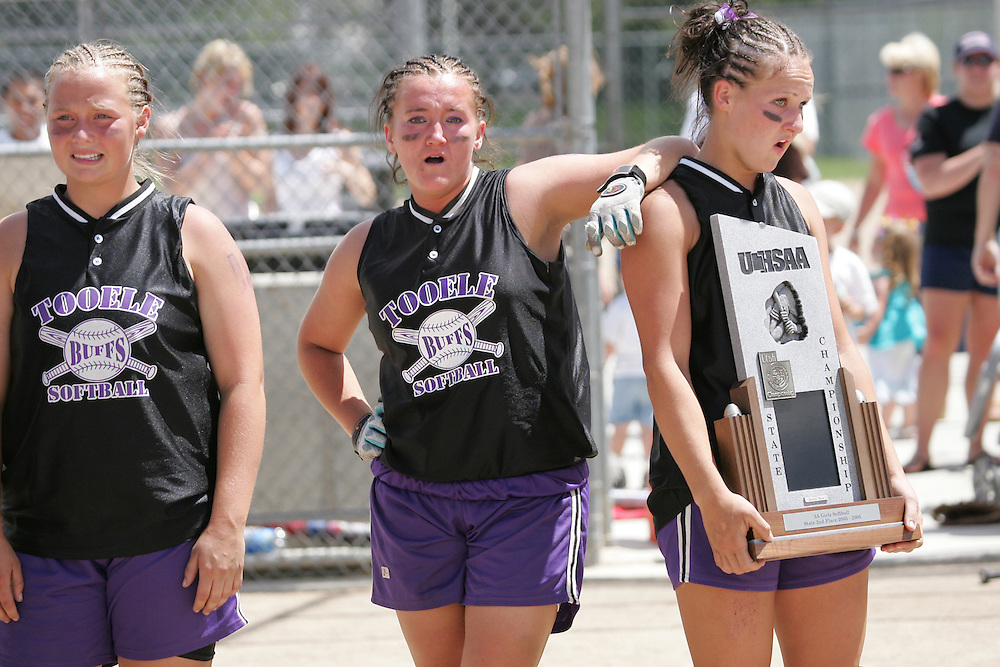 photography/Troy Boman&amp;#xA;Tooele seniors Amber Castagno (left) and Lindsey Palmer (right) fight back the tears after falling just short in the title game&amp;#xA;and accepting the silver team trophy Saturday at Cottonwood Complex. The Lady Buff seniors amassed three state championships,&amp;#xA;four trips to the state title game and a glossy 93-10 overall record in four seasons of Class 3A State softball.&amp;#xA;<br />