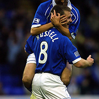 St Johnstone v Kilmarnock   24.11.01<br />Paul Hartley jumps on Craig Russell who scored the first goal<br /><br />Pic by Graeme Hart<br />Copyright Perthshire Picture Agency<br />Tel: 01738 623350 / 07990 594431