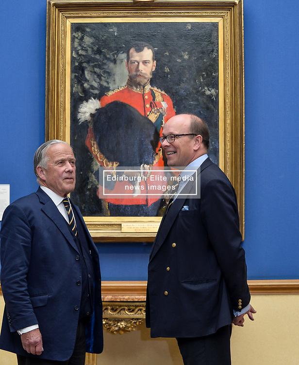Pictured: Chair of the Board of Trustees at the Royal Scots Dragoon Guards Museum Brigadier Mel Jameson (left) and current Colonel Brigadier David Allfrey (right) with the portrait as it goes on display.<br /> <br /> The Scottish National Gallery has unveiled details of a loan deal that will see Valentin Serov's rare portrait of Tsar Nicholas II go on display. The painting is owned by the Royal Scots Dragoon Guards Regimental Trust.<br /> <br /> © Dave Johnston / EEm