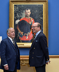 Pictured: Chair of the Board of Trustees at the Royal Scots Dragoon Guards Museum Brigadier Mel Jameson (left) and current Colonel Brigadier David Allfrey (right) with the portrait as it goes on display.<br /> <br /> The Scottish National Gallery has unveiled details of a loan deal that will see Valentin Serov's rare portrait of Tsar Nicholas II go on display. The painting is owned by the Royal Scots Dragoon Guards Regimental Trust.<br /> <br /> &copy; Dave Johnston / EEm