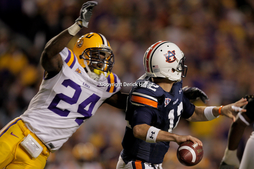 Oct 24, 2009; Baton Rouge, LA, USA; LSU Tigers linebacker Harry Coleman (24) just before hitting Auburn Tigers quarterback Chris Todd (12) to cause a fumble that was recovered by LSU during the first quarter at Tiger Stadium.  Mandatory Credit: Derick E. Hingle-US PRESSWIRE