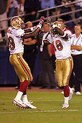 SAN DIEGO - SEPTEMBER 1:  Rookie wide receiver Fred Amey #18 of the San Francisco 49ers celebrates with teammate and rookie wide receiver Rasheed Marsall #89 after Amey catches a 23 yard touchdown pass against the San Diego Chargers during a preseason game on September 1, 2005 at Qualcomm Stadium in San Diego, California. The Chargers defeated the 49ers 28-24. ©Paul Anthony Spinelli *** Local Caption *** Fred Amey; Rasheed Marsall