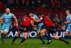 Dave Dennis of Exeter Chiefs is tackled by Dave Kilcoyne and Jean Kleyn of Munster Rugby - Mandatory by-line: Ken Sutton/JMP - 19/01/2019 - RUGBY - Thomond Park - Limerick,  - Munster Rugby v Exeter Chiefs -