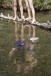 July 21, 2019 - Two Girls Standing On Log In Stream (Credit Image: © Carson Ganci/Design Pics via ZUMA Wire)