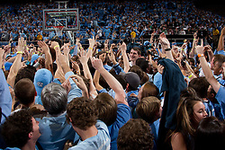 CHAPEL HILL, NC - MARCH 05: Fans of the North Carolina Tar Heels celebrate after rushing the court after a game against the Duke Blue Devils on March 05, 2011 at the Dean E. Smith Center in Chapel Hill, North Carolina. North Carolina won 67-81. (Photo by Peyton Williams/UNC/Getty Images)