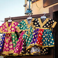 Festive children clothing on display at a local shop worn mainly on celebratory events.