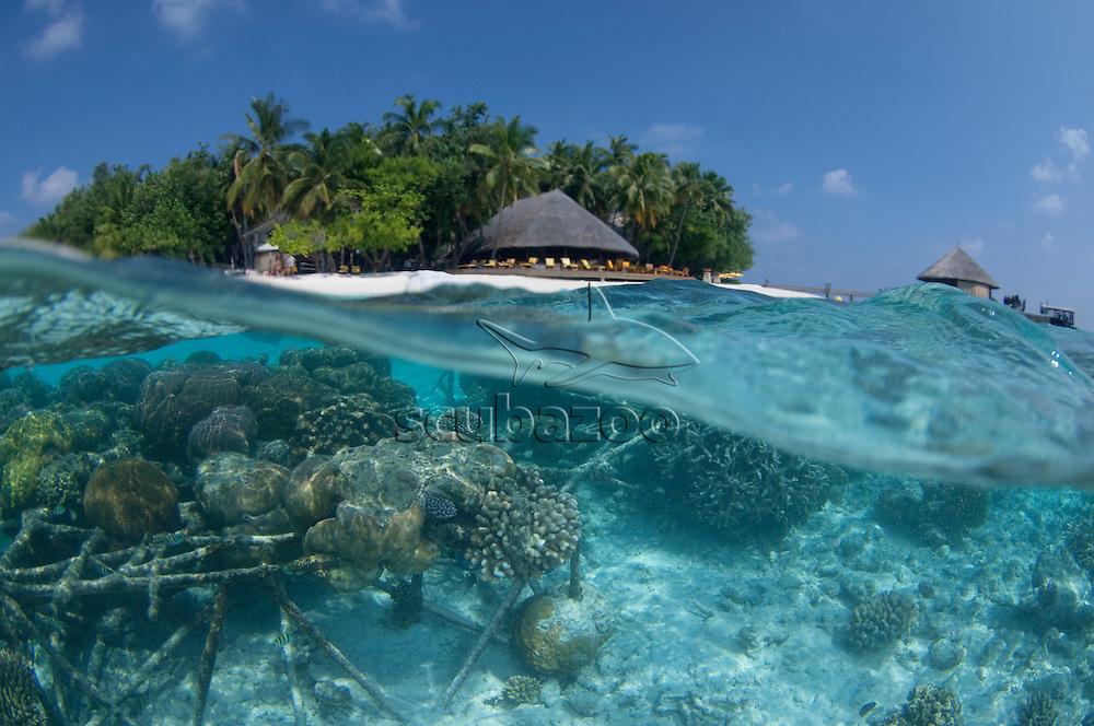Split shot of the Ihuru Necklace, an artificial reef for preventing beach erosion, Angsana Ihuru, North Male Atoll, The Maldives