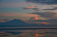 Mt. Agung in Bali reflected in the ocean at dawn from Sanur